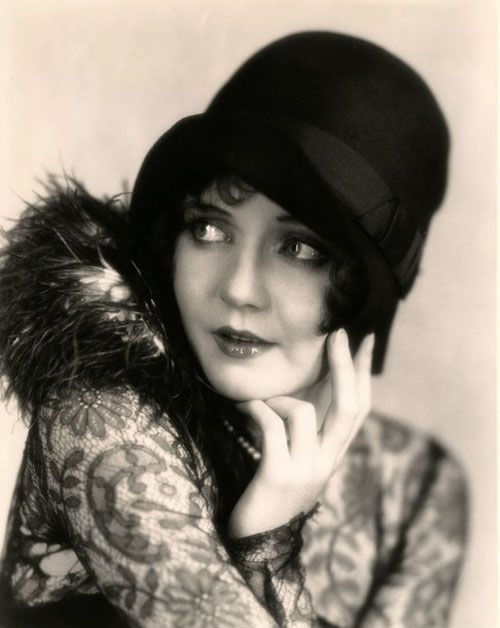 """The """"cloche"""" hat, fitted to the head, was popular during the """"flapper"""" era"""