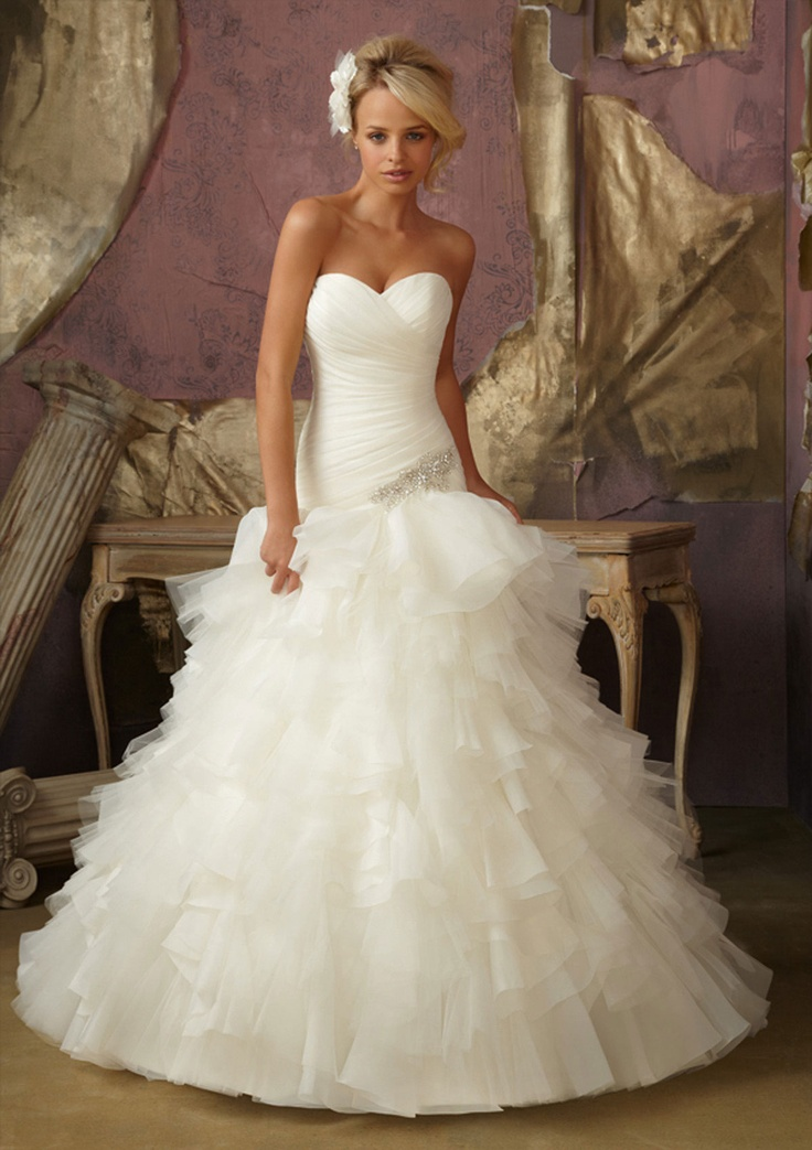 Mori Lee - strapless gown, fitted to hips but layers of ruffles to the floor. Also love the hair.
