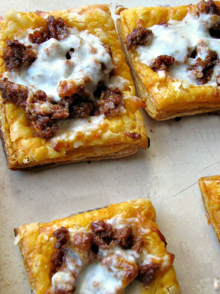 Cheesy Mexican Chorizo Puff Pastry Tarts are a spicy, cheesy, flaky appetizer great for munching on during the game or for a party!