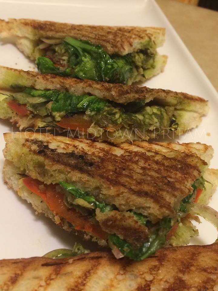 Italian Sandwich with Chicken and Grilled Veggies in a robust Pesto, served grilled. Our owners favourite snack/meal at the #CoffeeShop #HotelMidtownPritam