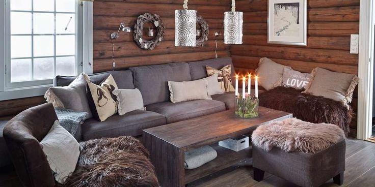 INSPIRERT AV NATUREN: Både materialene, fargene og tilbehøret på denne hytta er inspirert av naturen. Fargepaletten består av duse, nøytrale toner av grått, beige, svart og brunt.