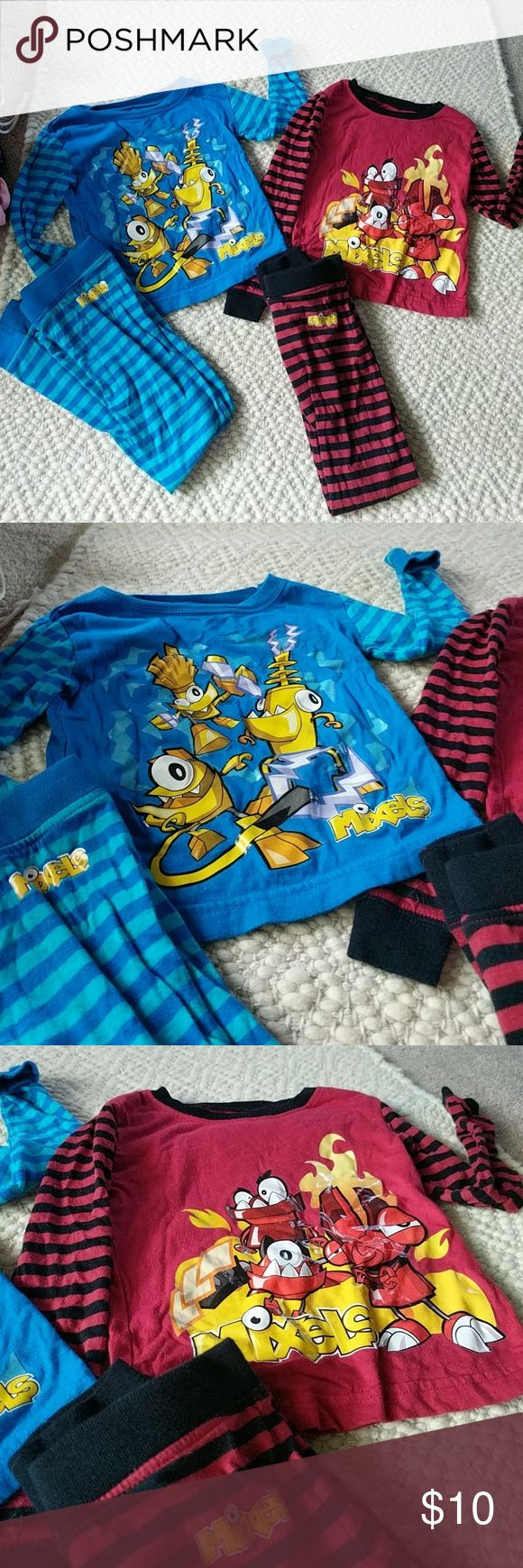 Mixels 2 Pair Pajama Set 100% Cotton Cute set for the Cartoon Network's show Mixels. Tops run small, much like PJs do these days. 100 % cotton. Sizes extra small 4/5. cartoon network Pajamas Pajama Sets