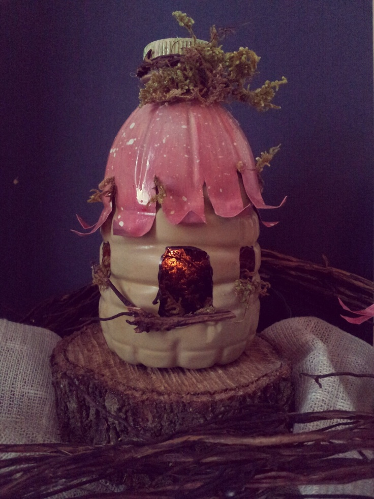 Woodland Fairy House - Recycled Bottles. $8.50, via Etsy. What a great idea!