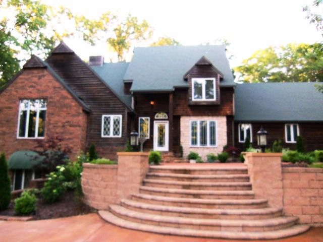 Elegance in a peaceful country setting. This beautiful 4 bedroom, 3 1/2 bath home is situated on 4.39 acres just outside the city limits. It is located approximately 1 mile from Marshfield Golf Course. This home has amazing professional landscaping with multi-level gardens, retaining walls and up-lighting creating a beautiful nighttime affect as well. Huge windows, multiple decks and many more amenities. Wired for Fiber Optics. Owner is a licensed Missouri Real Estate Agent in Marshfield MO