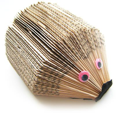 I pinned another tutorial on folding paperbacks in different patterns. The variation pattern could be used to make this.   Tutorial I'm referring to: http://www.frugalupstate.com/crafts-diy/diy-folded-paper-books/