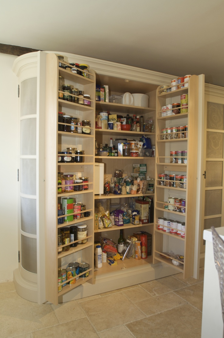 Double larder cupboard--Like how cans can fit in the doors. It needs drawers and a little more organization.