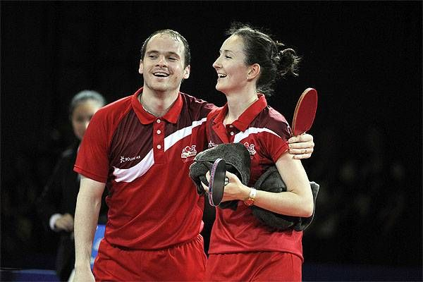 Day 10 action @ Glasgow CWG 2014  England's Paul Drinkhall and Joanna Drinkhall celebrate after winning the table tennis mixed doubles gold medal match against England's Tin Tin Ho and Liam Pitchford in the Scotstoun Sports Complex in Glasgow.