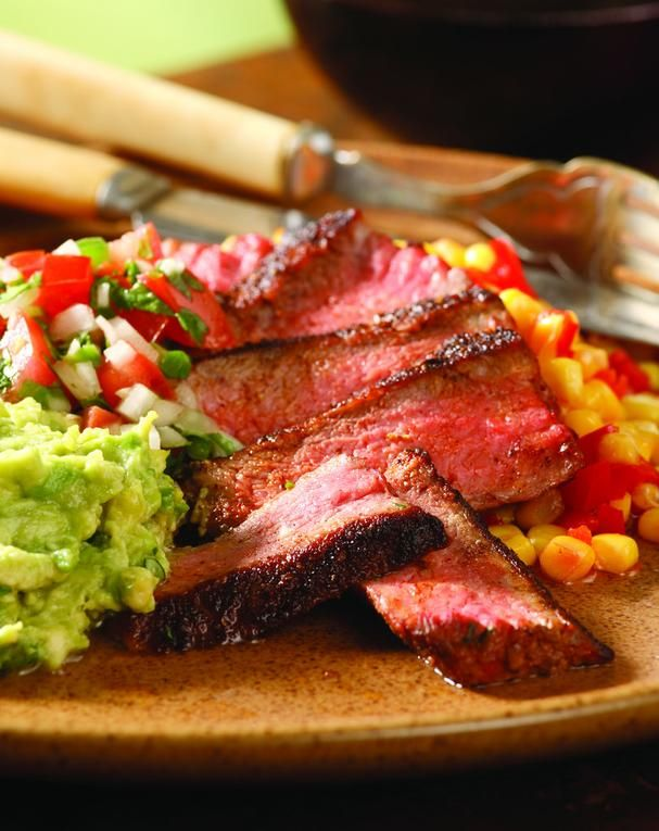 Chilean-Style Skillet Roasted Strip Steaks with Pebre Sauce & Avocado | For tonight's dinner, try this scrumptious Chilean-style Steak recipe that's served with a fresh, spicy, and tangy tomato and onion salsa known as pebre. Spoon it over a pan-seared steak and you have a meal that bursts with flavor in under 30 minutes!