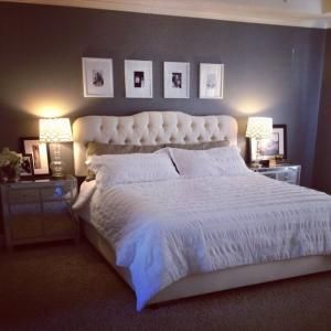 master bedroom makeover, Joss and Main bed and headboard, tufted headboard, Wayfair nightstands, mirrored tables, hotel, glam bedroom, hollywood glamour, white bedspread by chasity