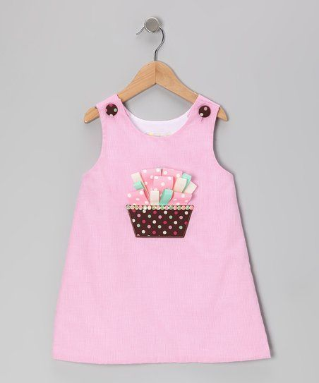 As timeless as it is effortless, this darling dress boasts two big, easy-to-open buttons on the shoulders. A cheery cupcake appliqué on the front also makes this frock as fun to see as it is to wear.