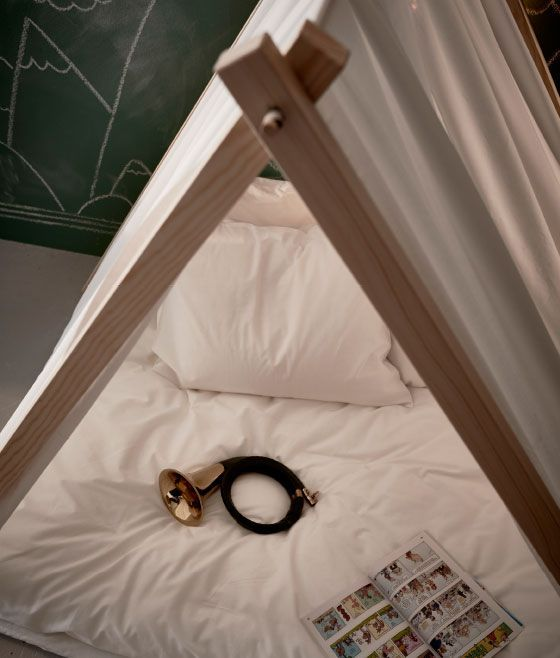 Prop your indoor tepee with blanket and pillows to make it extra cozy