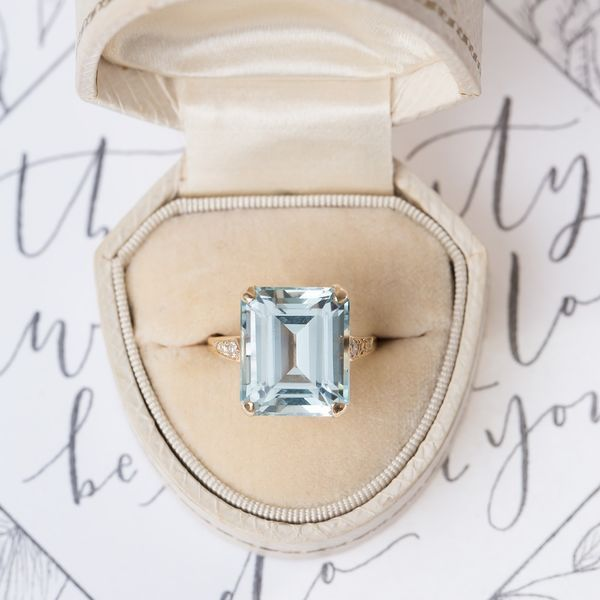This Art Deco gold ring makes our hearts skip a beat! The sea glass-colored aquamarine stone captures the whimsy and romance of any love story. | 10 Gorgeous Vintage Engagement Rings