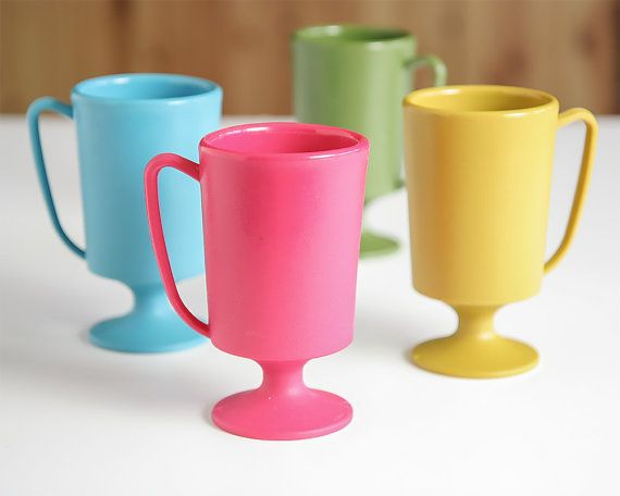 This is a fun set of four vintage retro colored plastic mugs. Each one is a different mid-century pop of color. They are in excellent vintage condition.