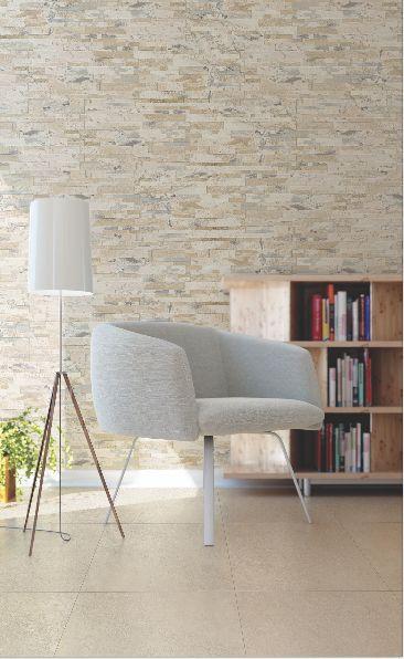 Logra un espacio armonioso ubicando elementos del mismo tono y combinándolo con paredes con textura.