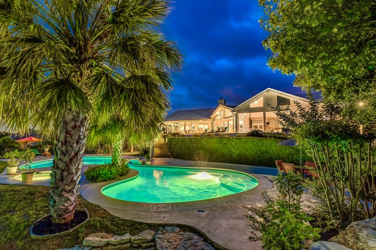 Super Unique Backyard for sale in Austin! Waterfalls, ponds, pool, spa, amazing hill country views! What's not to love! Realtor- Julie Mack