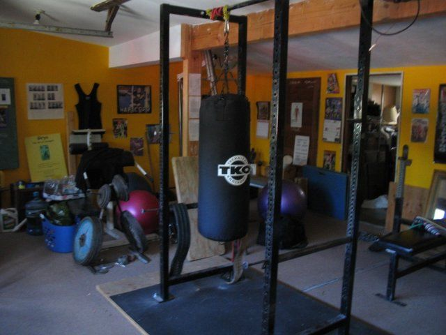 Boxing bag on power rack home gym pinterest