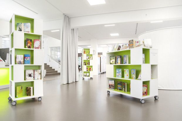Media Tower Display Furniture accommodates various media and new book displays on six shelves in a unit with wheels.