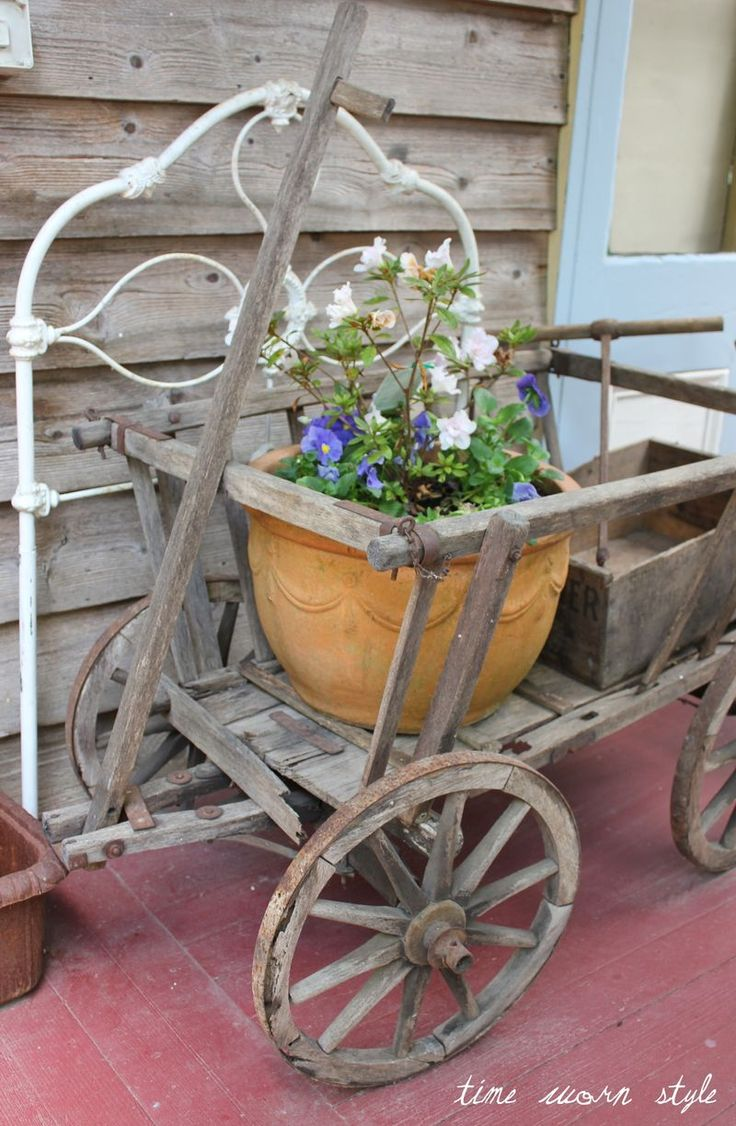 Using an old french wagon to carry a colourful pot