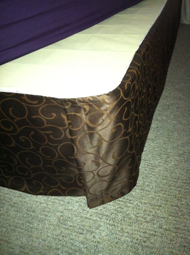 Single panel window curtain used to make queen bed skirt. Whip stitch directly onto box spring.