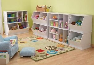 Great white storage units for baby books and toys =)