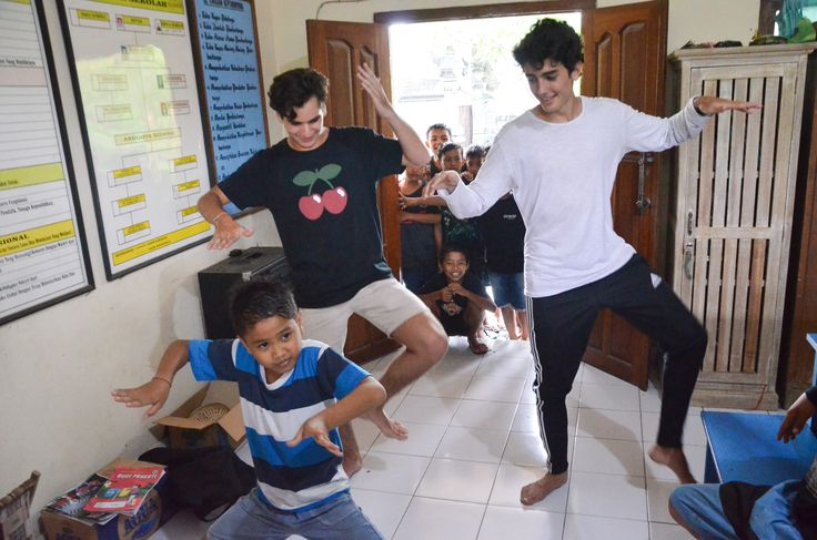 Our volunteers Patricio and Eduardo are learning how to do a Balinese dance from their student