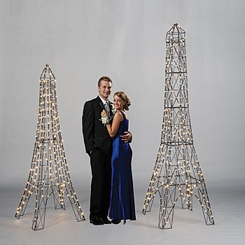 Our Illuminated Eiffel Tower decoration is sure to add shine to your Paris theme party! The metal Eiffel Tower is adorned with twinkle lights.