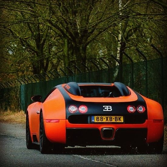 I Think This Sun Kissed Orange And Black Bugatti Is The