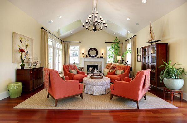 Coral interior design | traditional living room with coral colored comfy chairs