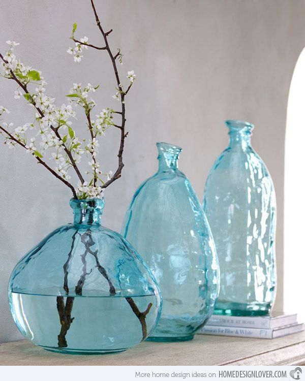 I love the different sizes and shapes of these turquoise vases. They also have an interesting rough and glossy texture.