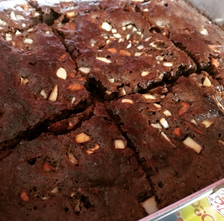 """Nothing screams """"pick me up"""" like a batch of good ol' chocolate brownies sprinkled with nuttiness! You just can't go wrong with this fool proof brownie recipe that is chewy inside and crunchy outside!"""