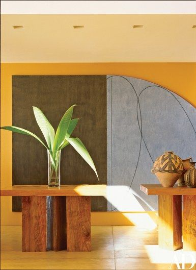 """Two of the dining table's three sections. """"We made leaves that link each section to the adjacent table. It can be configured to seat exactly as many guests as are present,"""" Wiseman explains. The painting is a 1997 work by Robert Mangold   archdigest.com   www.bocadolobo.com #bocadolobo #luxuryfurniture #exclusivedesign #interiodesign #designideas #dining #diningtable #luxuryfurniture #diningroom #interiordesign #table #moderndiningtable #diningtableideas #moderndiningroom #diningspace…"""