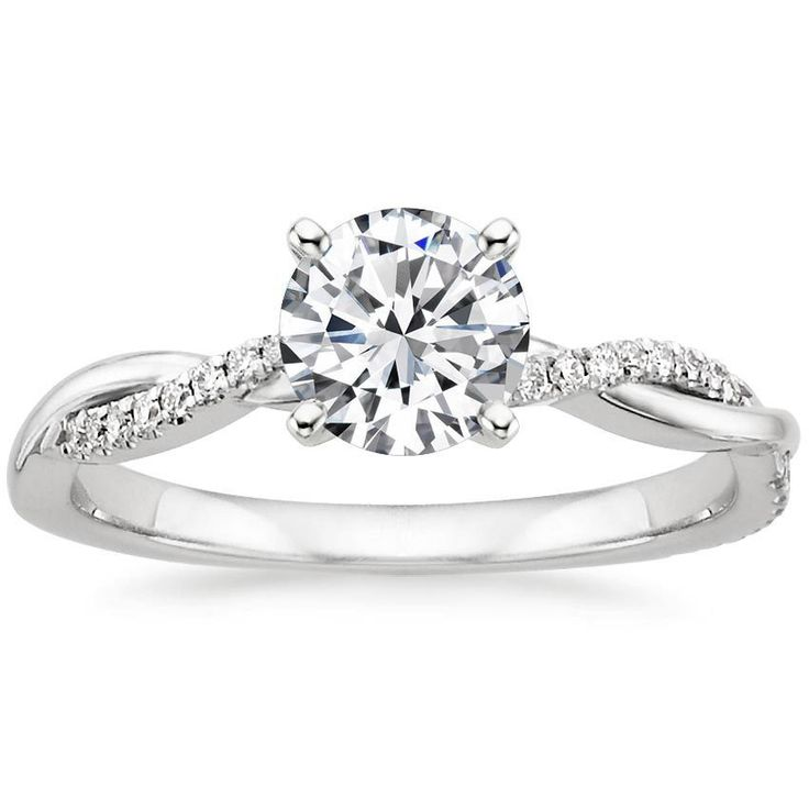 This 18K White Gold Petite Twisted Vine Diamond Ring has a 0.72 carat Round shaped conflict free diamond with D-color, IF-clarity, and Super Ideal-cut.