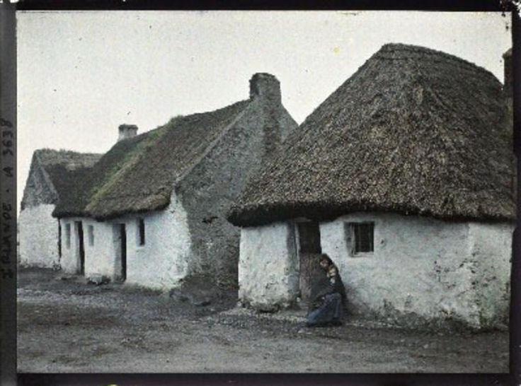 Mother and child outside dwelling, The Claddagh, Galway, Ireland, 25 May 1913…