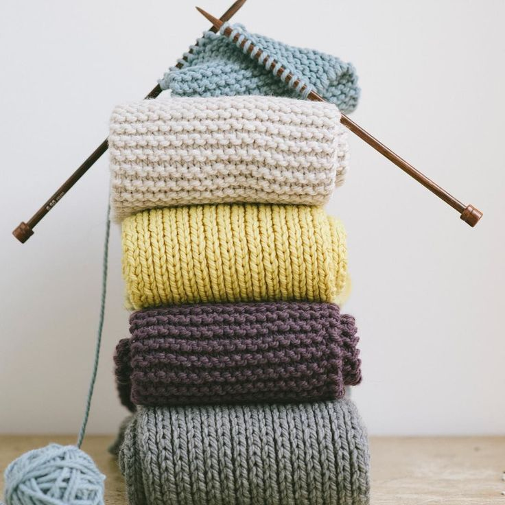 """Teach someone new how to knit with our Knit Kit - link in bio! Our illustrated book """"Knit: First Stitch/First Scarf"""" pretty skeins of Osprey to knit any of these lovely scarves shown here knitting needles a tapestry needle to weave in ends and a skill to last a lifetime--it's all here boxed up and ready for you to share.  #quinceandco"""