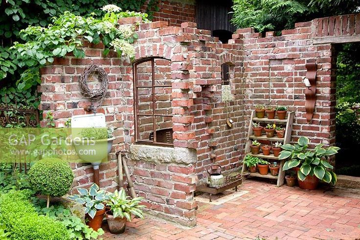 Paved patio with brick walls and window features