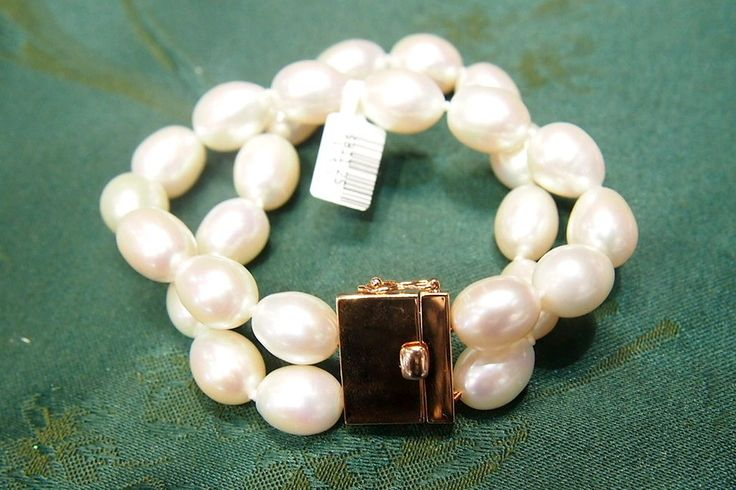 Pearl Bracelet withRose Gold by PearlPerfection Pearl Bracelet with twostands of 13mm white rice oval fresh water pearls and secure rose goldplated clasp (t