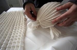Joan Sallas is known as the world's best virtuoso napkin folder.