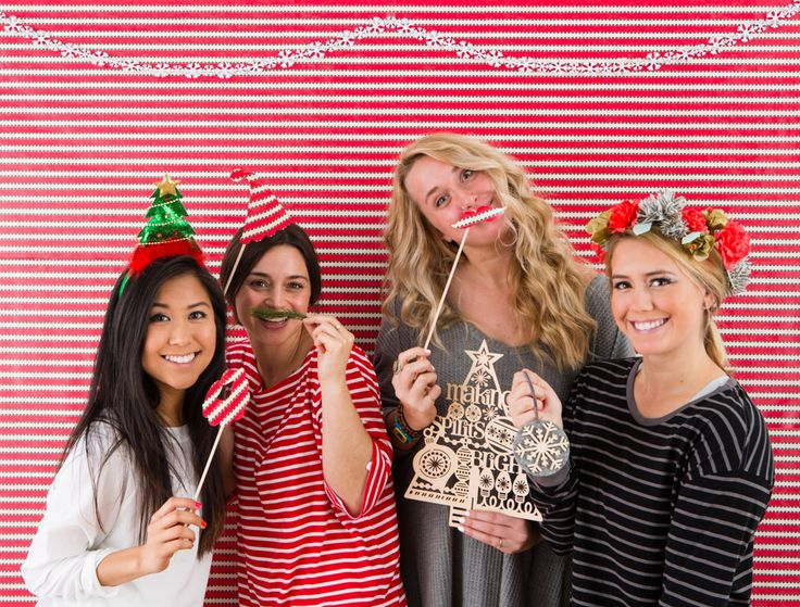 Use gift wrap to make this holiday photo booth.