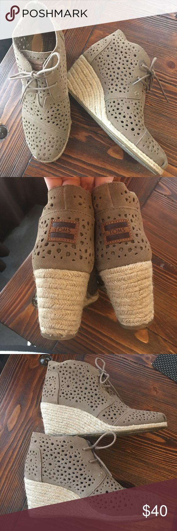 Toms Wedge booties size 8.5W Gorgeous booties. Wedge style, so you can feel comfortable all day. The inside has an elastic part so it will stretch with you. These were used only about 2-3 times. They are super cute! They have a small dot you can see on the fourth picture, but nothing major. 💙 Toms Shoes Ankle Boots & Booties