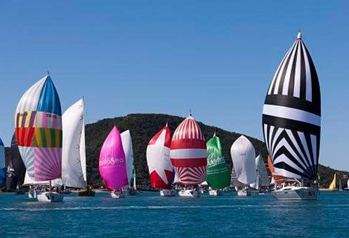 The vibrant sails of the yachts gracing Audi Hamilton Island Race Week. #HamiltonIsland #AHIRW