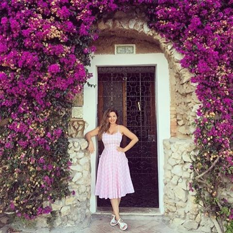 @iamkb Kelly Brook is always a vision in our dresses. Seen here in Capri, Italy wearing our Priscilla dress in pink gingham available at www.theprettydresscompany.com  #theprettydresscompamy #theprettydress #KellyBrook #Capri #Italy #romanholidays #1950sfashion #retrofashions #gingham #oohlalapr #ownwhoyouare #summer