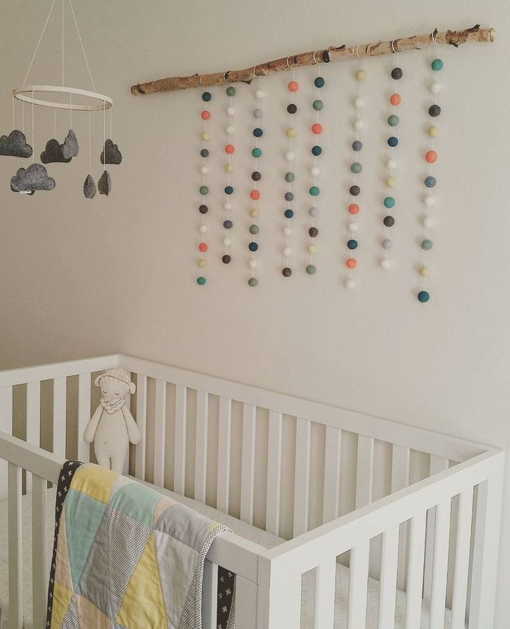 Modern gender neutral baby room. #trianglequilt #feltballs @vintagekitchn @splendidsundries @emma_cvb