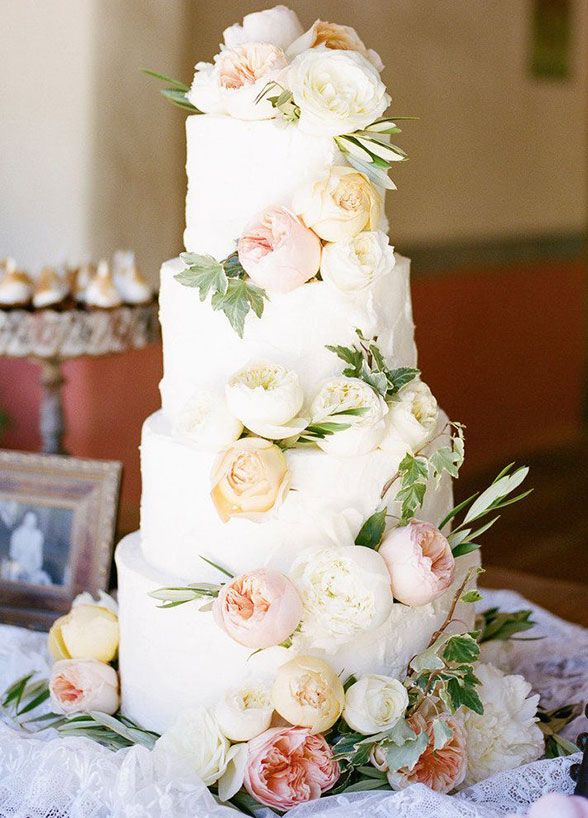 Take a slice of romance, soft pink and cream blooms cascade down this charming 4-tiered cake. Wedding Cakes, Wedding Cake Designs, Cake Decoration
