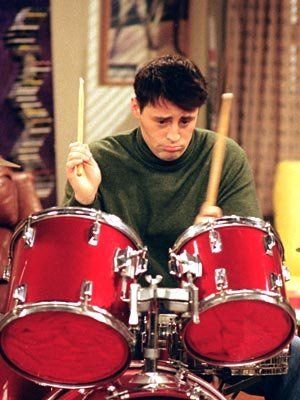 Joey playing the drums.