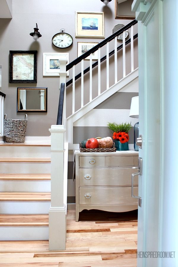 Cozy up the entry with cheery fall colors! A dresser makes the perfect fall hiding space for entryway clutter.