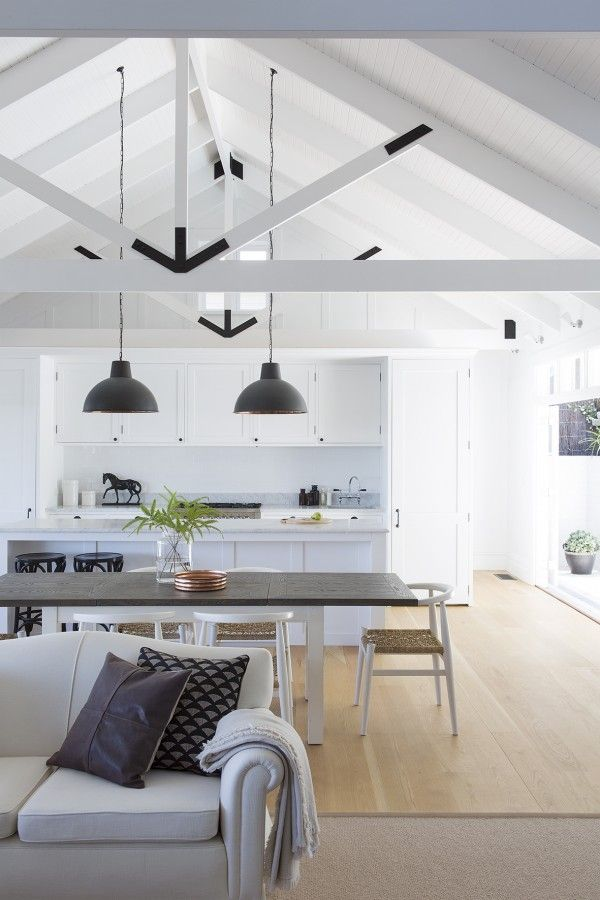 Exposing the trusses and having an airy cathedral ceiling is a fantastic way to inject a Hamptons aesthetic.