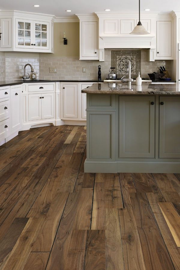 Love the taupe subway tile white cabinets gray island for Hardwood floor tile kitchen