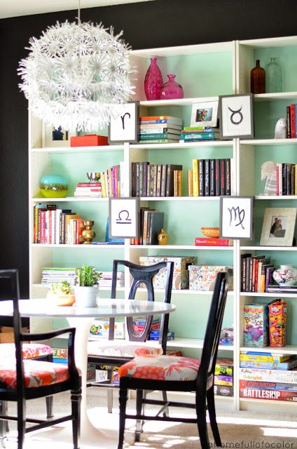 painted bookcases create an unexpected pop of color in an otherwise drab home office or library