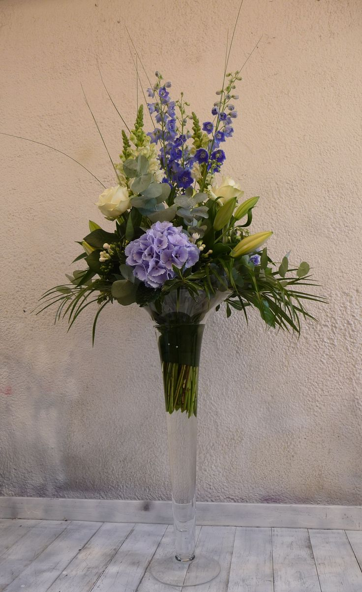 Blue & white arrangement, of Roses, Lilies, Hydrangeas, Delphiniums and Stocks, in a Lily Vase.