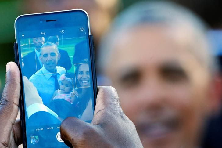 USA-OBAMA/CONGRESS A guest takes a picture of U.S. President Barack Obama as he hosts a congressional picnic event at the White House in Washington, U.S., June 14, 2016. REUTERS/Carlos Barria